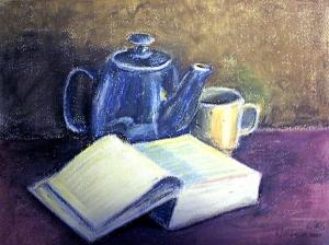 Buch und Teekanne